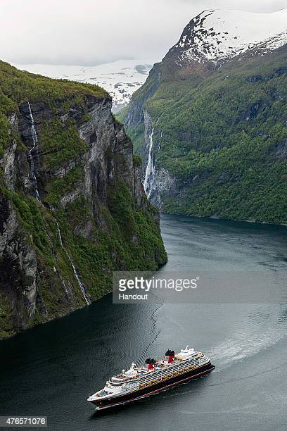 In this handout photo provided by Disney Parks A general view of the Disney Magic cruise arriving in Geiranger Norway on June 10 2015 in Geiranger...