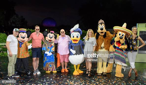 In this handout photo provided by Disney Parks ABC's Emmyaward winning show 'The Chew' cohosts Michael Symon Clinton Kelly Mario Batali Daphne Oz and...
