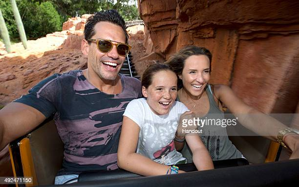 In this handout photo provided by Disney Parks actor Cristian de la Fuente wife and actress Angelica Castro and their daughter Laura de la Fuente...