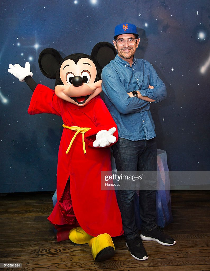 In this handout photo provided by Disney Parks actor Ty Burrell from Modern Family meets with Mickey Mouse during a visit to Disneyland Park in...