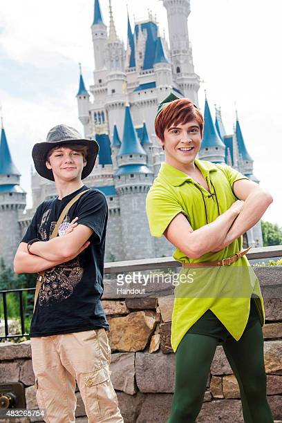 In this handout photo provided by Disney Parks actor Ty Simpkins celebrates his 14th birthday alongside Peter Pan at Walt Disney World Resort on...
