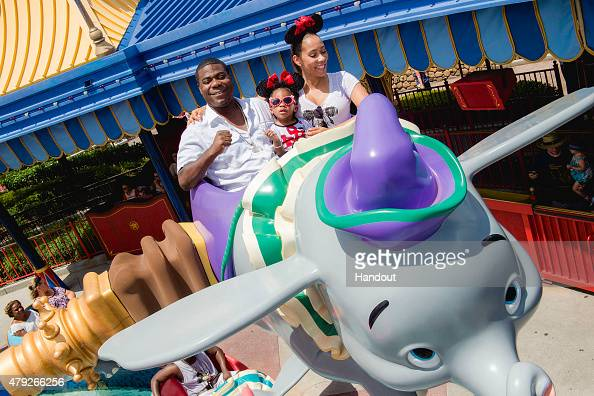 In this handout photo provided by Disney Parks actorcomedian Tracy Morgan fiancee Megan Wollover and daughter Maven Morgan take flight July 2 2015 on...