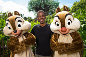 In this handout photo provided by Disney Parks actorcomedianproducer Chris Rock poses with Chip and Dale at Disney's Animal Kingdom park Auguest 18...