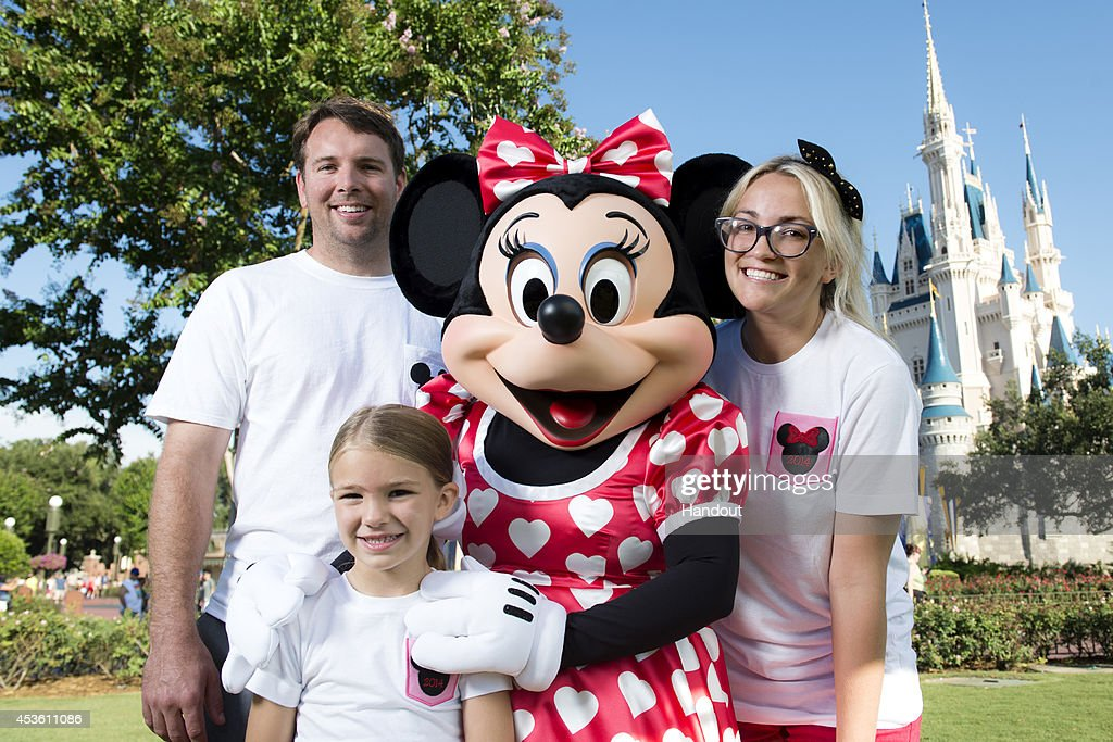 In this handout photo provided by Disney Parks, actress and country music artist <a gi-track='captionPersonalityLinkClicked' href=/galleries/search?phrase=Jamie+Lynn+Spears&family=editorial&specificpeople=212787 ng-click='$event.stopPropagation()'>Jamie Lynn Spears</a> poses with her husband, Jamie Watson, her six-year-old daughter Maddie and Minnie Mouse in front of Cinderella Castle at the Magic Kingdom park August 14, 2014 in Lake Buena Vista, Florida. Spears, the sister of pop superstar Britney Spears and former star of 'Zoey 101' on Nickelodeon, lives in Nashville, Tenn. and is currently on tour to support her first country music single. Her sister Britney launched her career at Walt Disney World, starring in 'The All-New Mickey Mouse Club' that taped at Disney's Hollywood Studios theme park.