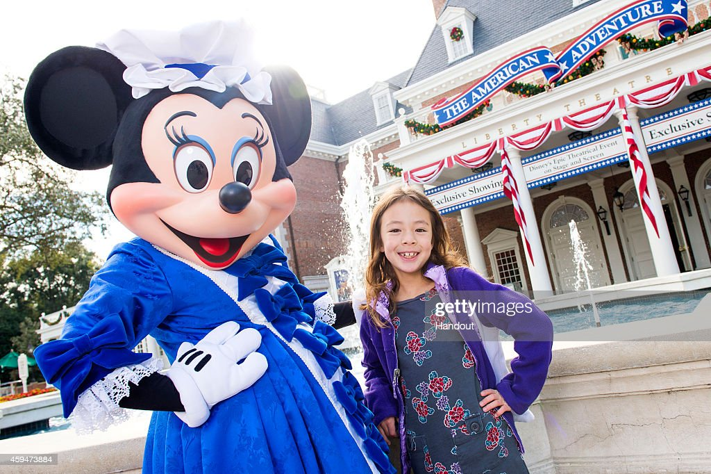In this handout photo provided by Disney Parks actress Aubrey AndersonEmmons poses with Minnie Mouse at The American Adventure attraction at Walt...