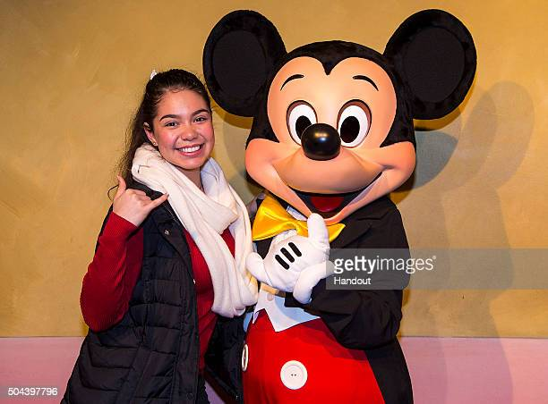 In this handout photo provided by Disney Parks actress Auli'i Cravalho who voices Moana in Walt Disney Animation Studios upcoming film 'Moana' meets...