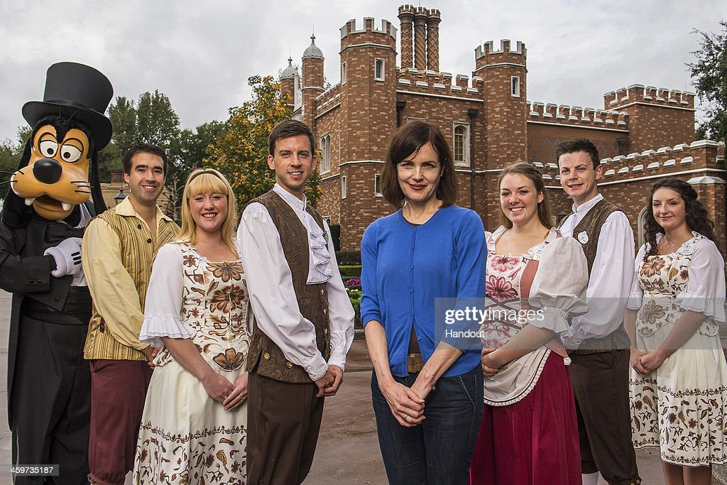 In this handout photo provided by Disney Parks, actress Elizabeth McGovern of 'Downton Abbey' poses with Goofy and Disney employees at Epcot's United Kingdom Pavilion to recreate the 'Downton Abbey' cast photo at Walt Disney World Resort on December 29, 2013 in Lake Buena Vista, Florida.