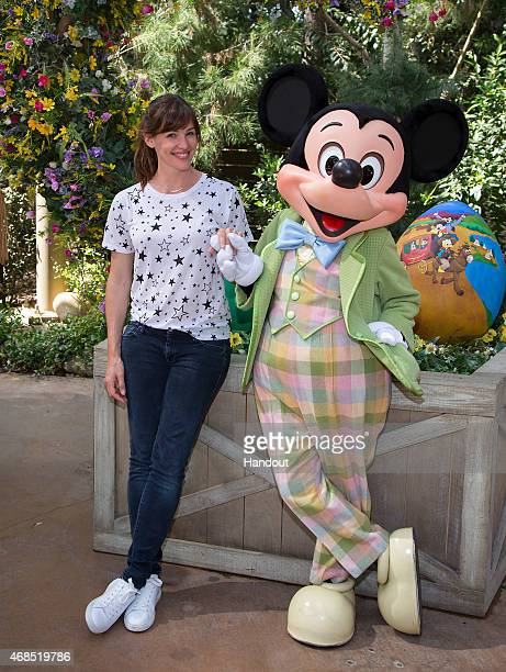 In this handout photo provided by Disney Parks actress Jennifer Garner poses with Mickey Mouse at Springtime Roundup at Disneyland Park April 2 2015...