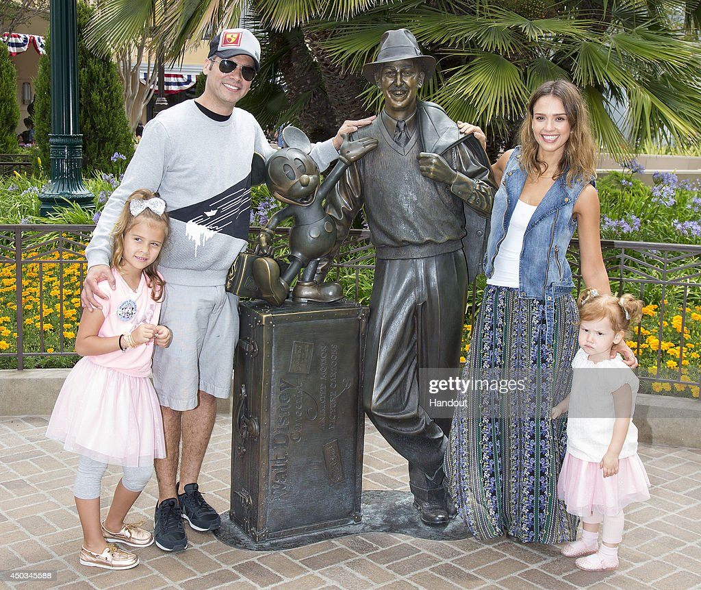 In this handout photo provided by Disney Parks actress Jessica Alba her husband Cash Warren and daughters Haven Warren and Honor Warren celebrating...