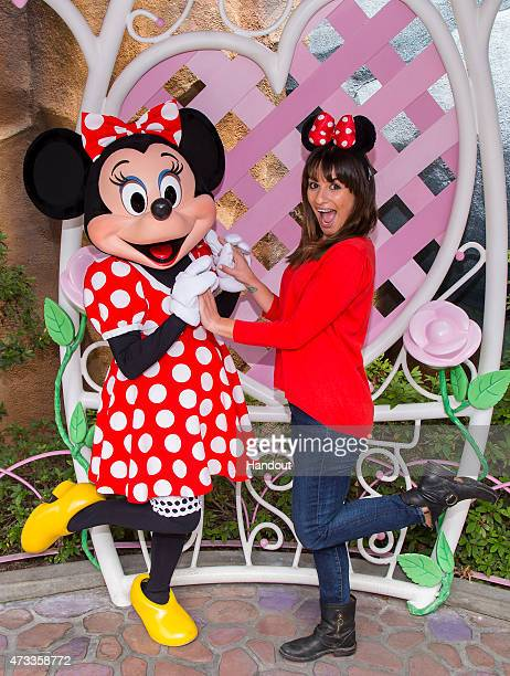 In this handout photo provided by Disney Parks actress Lea Michele poses with Minnie Mouse in Mickey's Toontown May 14 2015 at Disneyland park in...