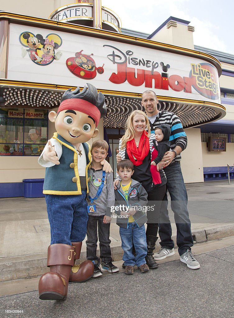 In this handout photo provided by Disney Parks, Actress Melissa Joan Hart, musician/husband Mark Wilkerson and children, (L-R) Mason Wilkerson, Braydon Wilkerson and Tucker Wilkerson pose with Jake of 'Jake and The Never Land Pirates'at Disney Junior: Live On Stage! inside of Disney's California Adventure Park on March 9, 2013 in Anaheim, California.