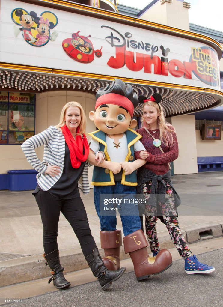 In this handout photo provided by Disney Parks, Actresses Melissa Joan Hart and Taylor Spreitler pose with Jake of 'Jake and The Never Land Pirates' at Disney Junior: Live On Stage! inside of Disney's California Adventure Park on March 9, 2013 in Anaheim, California.