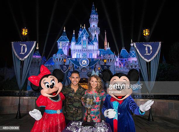 In this handout photo provided by Disney Parks Alexa PenaVega and Carlos PenaVega are joined by Mickey Mouse and Minnie Mouse at Disneyland park...