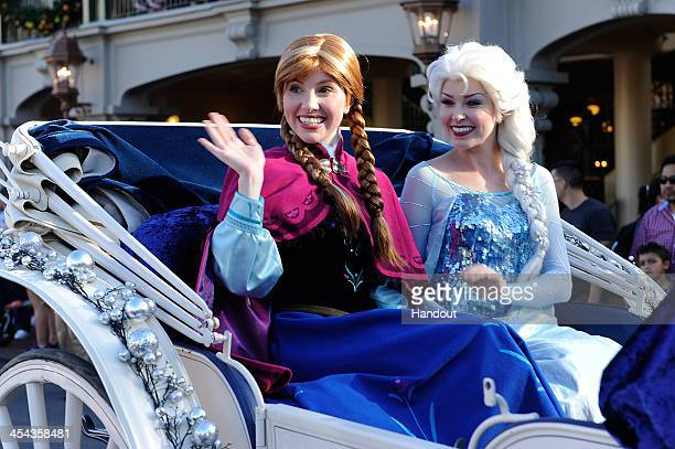 In this handout photo provided by Disney Parks 'Anna' and 'Elsa' from the film 'Frozen' particiapte in the Disney Parks Christmas Day Parade...