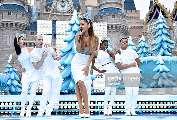 In this handout photo provided by Disney Parks Ariana Grande performs 'Last Christmas' and 'Santa Tell Me' during the taping of the Disney Parks...