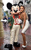 In this handout photo provided by Disney Parks Ariana Grande poses with Mickey Mouse during the taping of the Disney Parks 'Frozen Christmas...