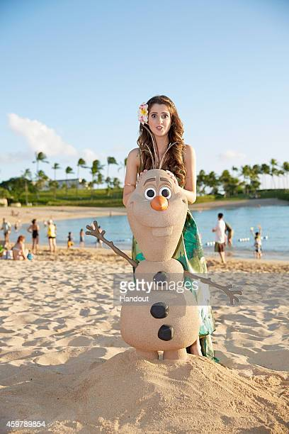 In this handout photo provided by Disney Parks 'Austin Ally' star Laura Marano is photographed on the beach at Aulani a Disney Resort Spa during...