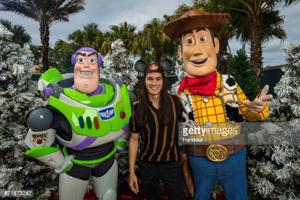 In this handout photo provided by Disney Parks Boo Boo Stewart with Buzz Lightyear and Woody attends a taping of Disney Parks Presents a Disney...