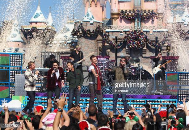 In this handout photo provided by Disney Parks Brian Littrell Kevin Richardson Howie Dorough Nick Carter and AJ McLean of the Backstreet Boys pose...