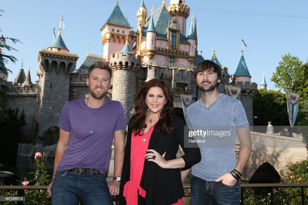 In this handout photo provided by Disney Parks, (L-R) Charles Kelley, Hillary Scott and Dave Haywood of Lady Antebellum make a special appearance at Disneyland to perform for contest winners on April 28, 2013 in Anaheim, California.