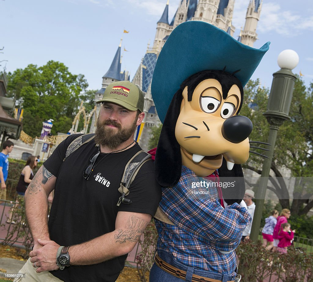 In this handout photo provided by Disney Parks, country music artist Zac Brown, singer/songwriter for the Zac Brown Band, poses with Goofy at the Magic Kingdom park on March 18, 2013 in Lake Buena Vista, Florida. Zac Brown Band won 'Best Country Album' for their latest release, 'Uncaged,' at the 55th GRAMMY Awards held February 10, 2013. Magic Kingdom is one of four theme parks at Walt Disney World Resort in Florida.