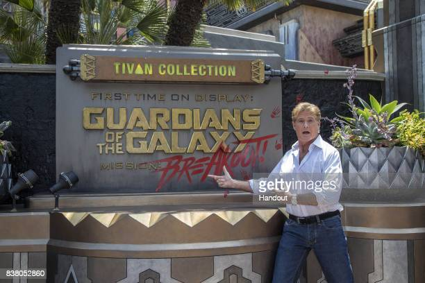 In this handout photo provided by Disney Parks David Hasselhoff poses outside the Guardians of the Galaxy Mission Breakout attraction during the...