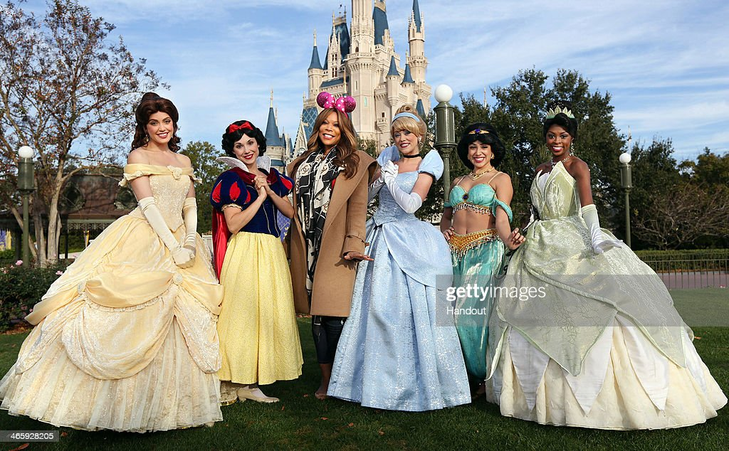 In this handout photo provided by Disney Parks daytime TV talk show host Wendy Williams poses with Disney Princesses Belle Snow White Cinderella...
