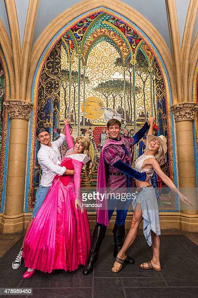 In this handout photo provided by Disney Parks Derek Hough and Julianne Hough pose with Princess Aurora and Prince Phillip at Magic Kingdom theme...