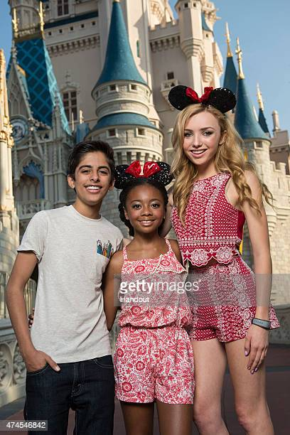 In this handout photo provided by Disney Parks Disney Channel's 'Jessie' stars Karan Brar Skai Jackson and Peyton List pose in front of the...