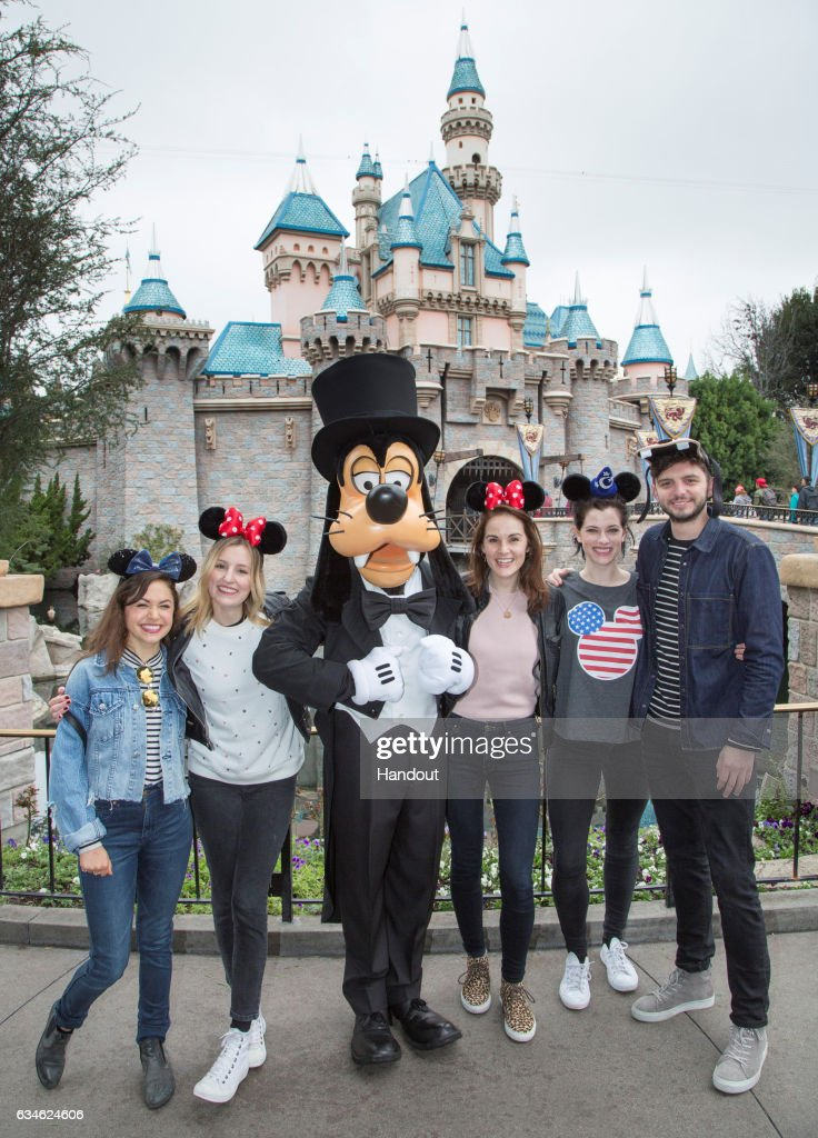 In this handout photo provided by Disney Parks, 'Downton Abbey' co-stars Laura Carmichael (2nd from L), Michelle Dockery (C) and Michael Fox (R) are joined by actors Kelly Paterniti and Jessica de Gouw as they meet Goofy outside Sleeping Beauty Castle at Disneyland park on February 10, 2017 in Anaheim, California.