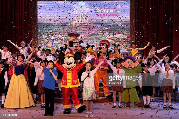 In this handout photo provided by Disney Parks dressed in a traditional Chinese costume Mickey Mouse joins other Disney characters and a 50voice...