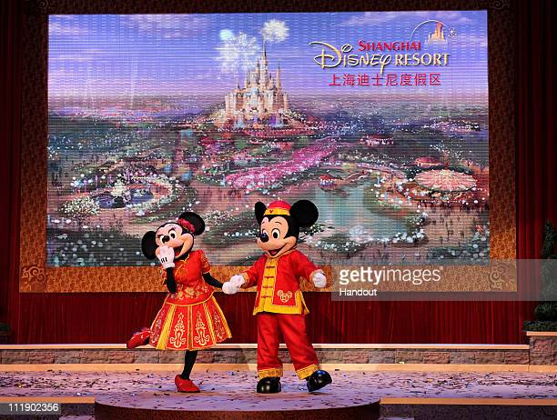In this handout photo provided by Disney Parks dressed in traditional Chinese costumes Minnie Mouse and Mickey Mouse acknowledge the crowd in...