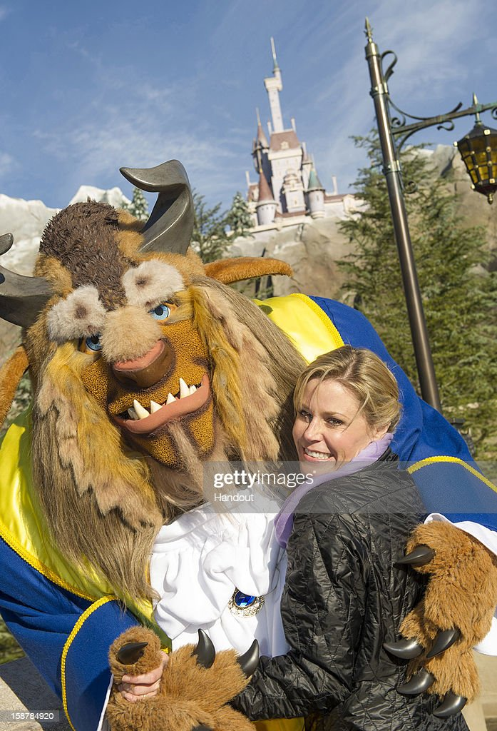 In this handout photo provided by Disney Parks, Emmy Award-winning actress Julie Bowen, star of ABC's comedy series 'Modern Family,' takes a waltz with The Beast from Disney's 'Beauty and the Beast' in New Fantasyland at the Magic Kingdom theme park December 28, 2012 in Lake Buena Vista, Florida.