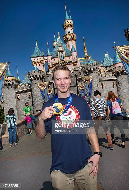 In this handout photo provided by Disney Parks firstever Olympic ski halfpipe gold medalist David Wise celebrates his achievement in Sochi with a...