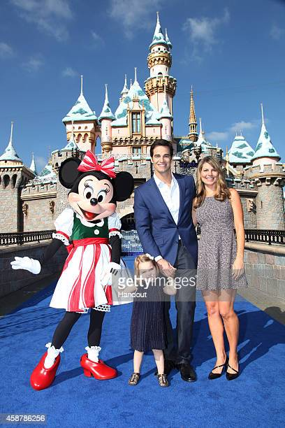 In this handout photo provided by Disney Parks Good Morning America Weekend Senior Meterologist Rob Marciano with wife Eryn Marciano and daughter...