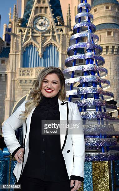 In this handout photo provided by Disney Parks Grammy awardwinning singersongwriter Kelly Clarkson poses between performances for the ABC and Disney...