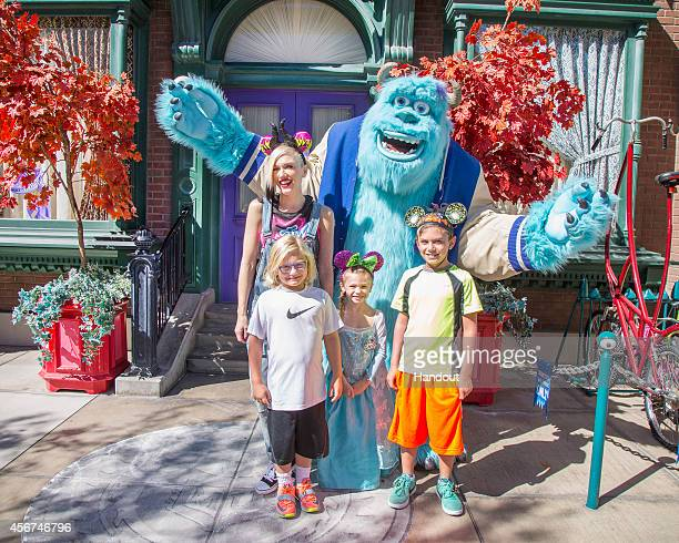 In this handout photo provided by Disney Parks Gwen Stefani and her sons Kingston Rossdale and Zuma Rossdale and niece Stella meet Sulley from the...