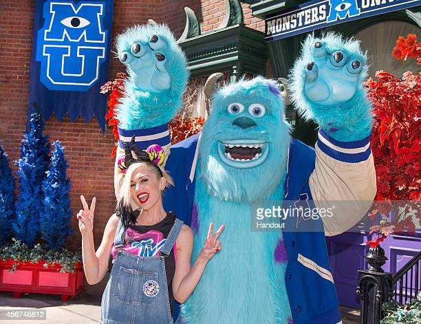 In this handout photo provided by Disney Parks Gwen Stefani meets Sulley from the DisneyPixar films 'Monsters Inc' and 'Monsters University' at...