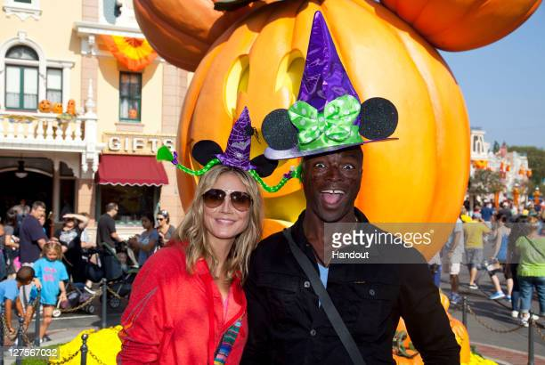 In this handout photo provided by Disney Parks Heidi Klum and Seal celebrate Halloween Time at Disneyland on September 29 2011 in Anaheim California...