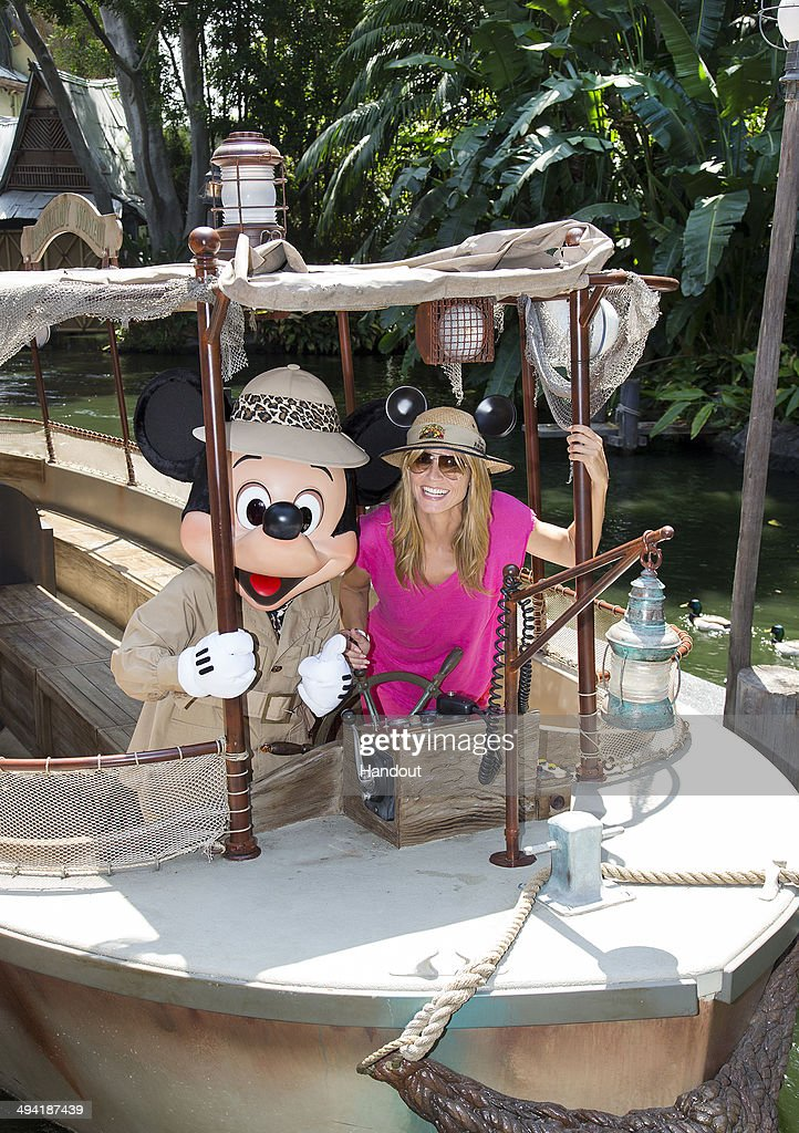 In this handout photo provided by Disney Parks, <a gi-track='captionPersonalityLinkClicked' href=/galleries/search?phrase=Heidi+Klum&family=editorial&specificpeople=178954 ng-click='$event.stopPropagation()'>Heidi Klum</a> joins Mickey Mouse aboard the world-famous Jungle Cruise attraction May 28, 2014 at Disneyland in Anaheim, California.
