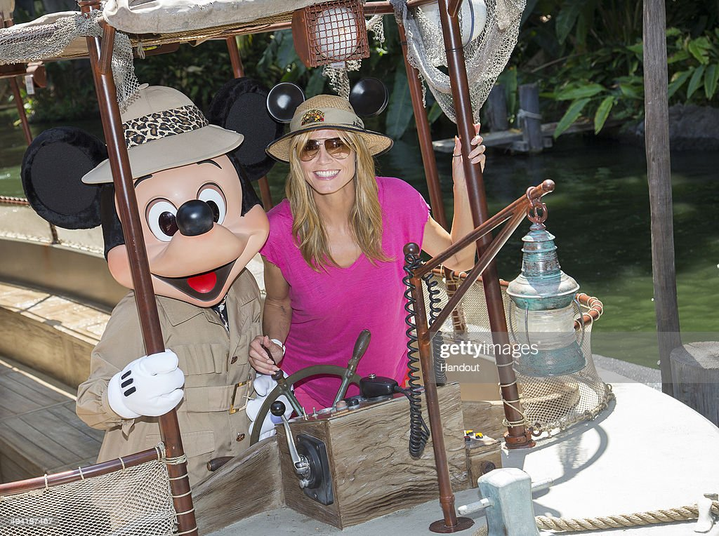 In this handout photo provided by Disney Parks, Heidi Klum joins Mickey Mouse aboard the world-famous Jungle Cruise attraction May 28, 2014 at Disneyland in Anaheim, California.