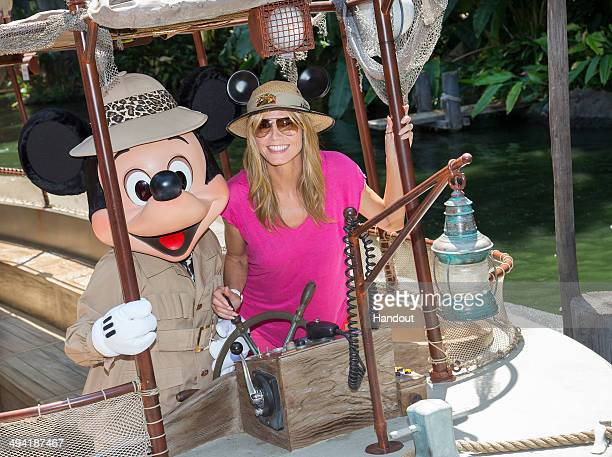 In this handout photo provided by Disney Parks Heidi Klum joins Mickey Mouse aboard the worldfamous Jungle Cruise attraction May 28 2014 at...