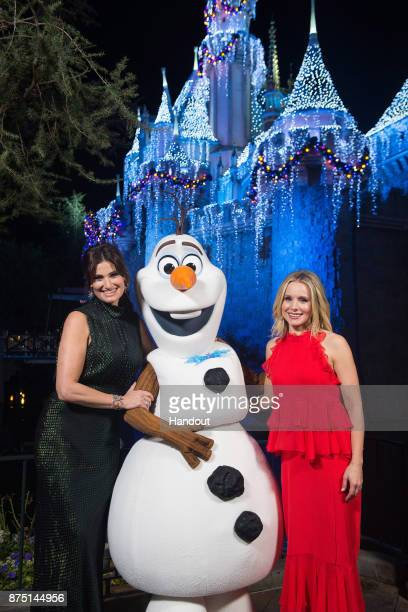In this handout photo provided by Disney Parks Idina Menzel and Kristen Bell of 'Frozen' pose with Olaf before a taping of 'The Wonderful World of...