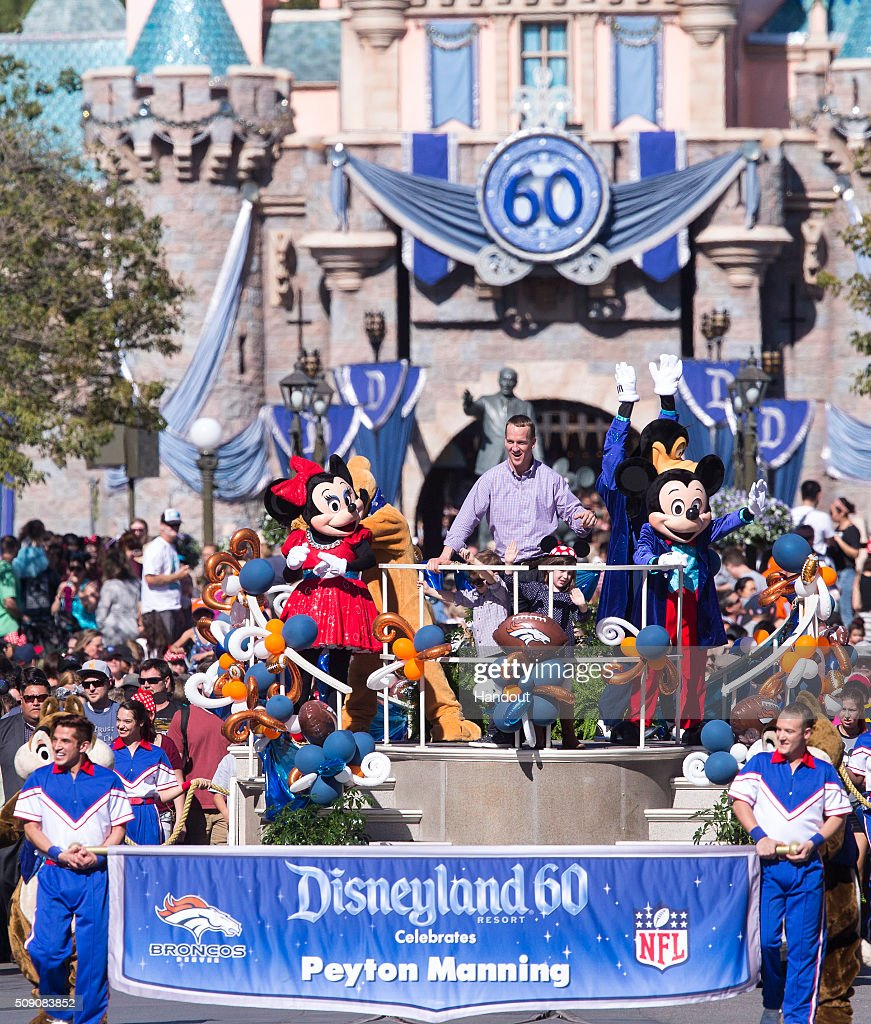 In this handout photo provided by Disney Parks, In honor of the Denver Broncos' victory at Super Bowl 50, the Disneyland Resort saluted quarterback <a gi-track='captionPersonalityLinkClicked' href=/galleries/search?phrase=Peyton+Manning&family=editorial&specificpeople=184524 ng-click='$event.stopPropagation()'>Peyton Manning</a> with a champions parade down Main Street, U.S.A. at Disneyland Park in Anaheim, Calif., on Monday February 8, 2016. Some favorite Disney characters joined the parade as Manning rode in a float with his children, Mosely and Marshall.