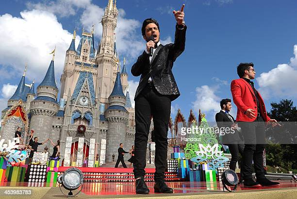 In this handout photo provided by Disney Parks Italian pop vocal trio IL VOLO performs 'Feliz Navidad' while taping the Disney Parks Christmas Day...