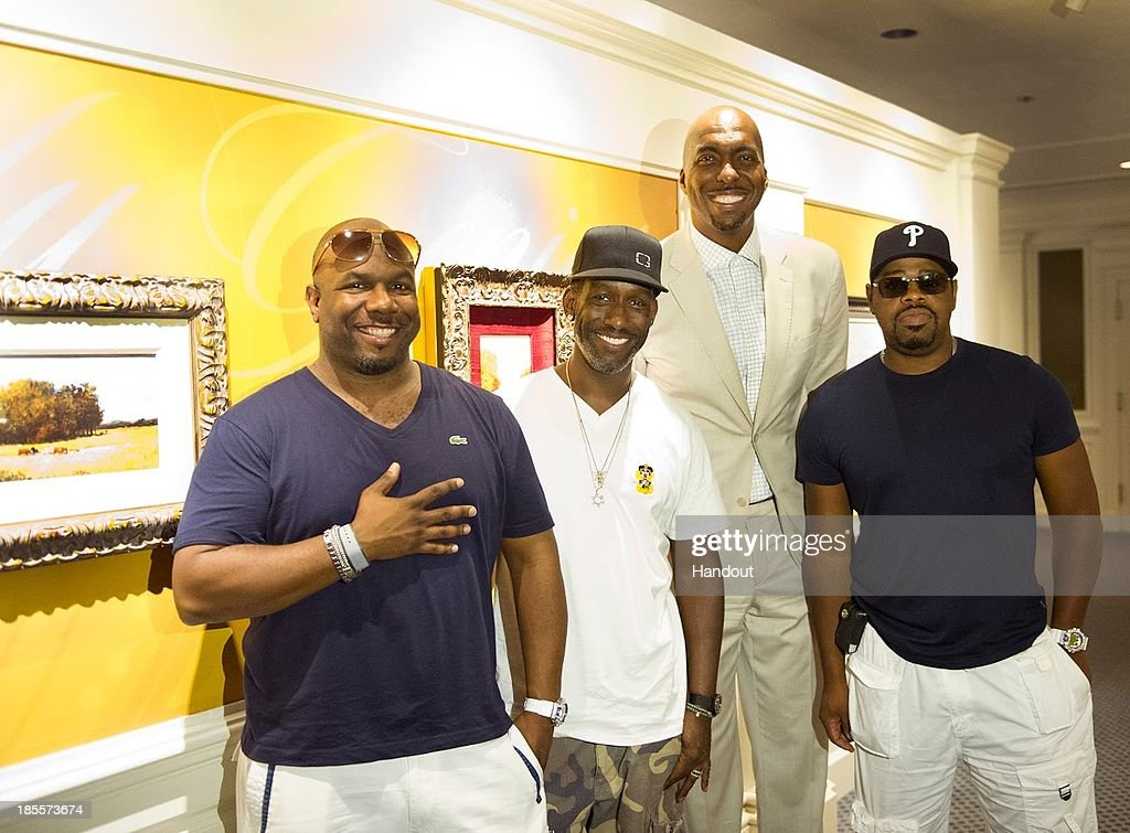 In this handout photo provided by Disney Parks, John Salley (C) poses with (L-R) Wanya Morris, Shawn Stockman and Nate Morris of Boyz II Men at Epcot Theme Park on October 21, 2013 in Lake Buenva Vista, Florida.