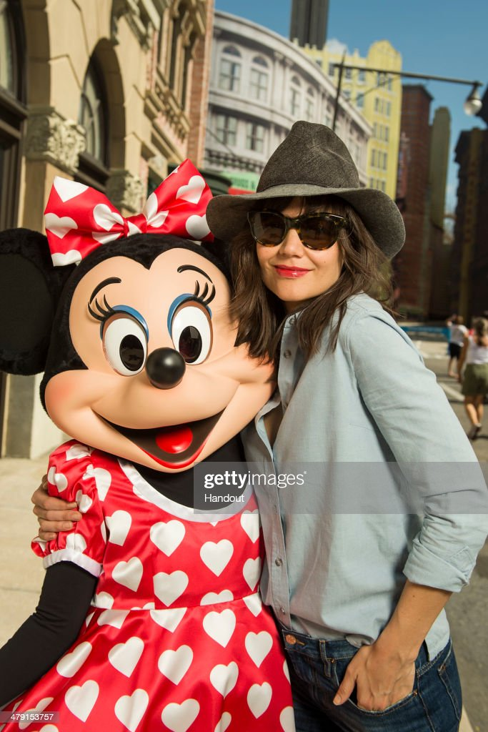 In this handout photo provided by Disney Parks, Katie Holmes poses with Minnie Mouse in the New York Street area of Disney's Hollywood Studios on March 16, 2014 at Walt Disney World Resort in Lake Buena Vista, Florida.