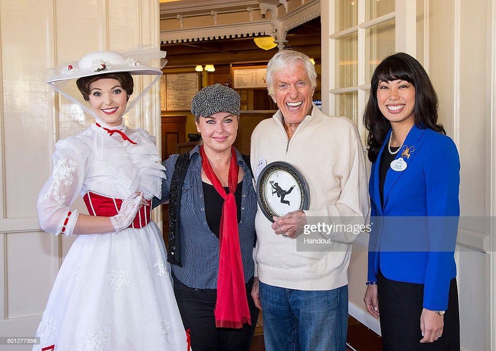 In this handout photo provided by Disney Parks, Mary Poppins, Arlene Silver Van Dyke, actor and Disney legend Dick Van Dyke and Disneyland Resort Ambassador, Allie Kawamoto celebrate his 90th birthday at Disneyland on December 13, 2015 in Anaheim, California.