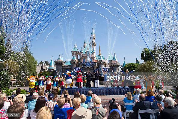 In this handout photo provided by Disney parks Mickey Mouse and his friends celebrate the 60th anniversary of Disneyland park during a ceremony at...
