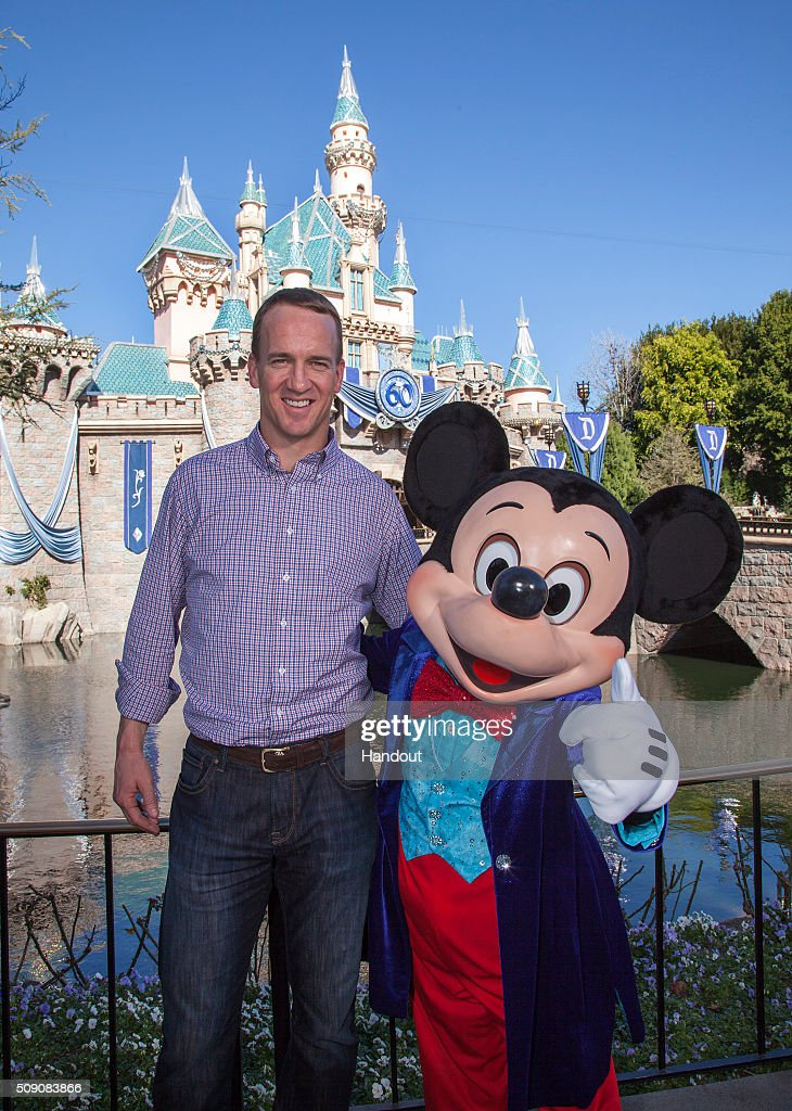In this handout photo provided by Disney Parks, Mickey Mouse greets Denver Broncos quarterback <a gi-track='captionPersonalityLinkClicked' href=/galleries/search?phrase=Peyton+Manning&family=editorial&specificpeople=184524 ng-click='$event.stopPropagation()'>Peyton Manning</a> at Sleeping Beauty Castle at Disneyland park in Anaheim, Calif., on Monday February 8, 2016. In honor of the Denver Broncos' victory at Super Bowl 50, the Disneyland Resort saluted Manning with a champions parade down Main Street, U.S.A.